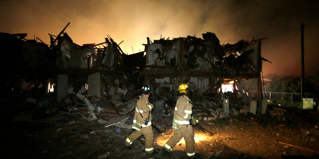 Loading Firefighters check a destroyed apartment complex near the fertilizer plant that exploded earlier in West, Texas. Photo / AP