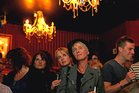 Robyn Paterson, centre left, and Paula Boock, right, watch the final reading on Parliament TV at the Caluzzi Bar and Cabaret. Photo / Getty Images