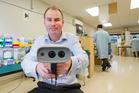IkeGPS CEO Glenn Milnes with the company's hand-held surveying instrument. Photo / Mark Mitchell