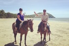 Tash takes a horse ride on Cape Tribulation beach. Photo / Supplied
