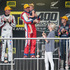 Race winner Jason Bright holding Sienna Richards celebrates after winning Sundays racing of the ITM 400 in Auckland at Pukekohe Park Raceway. Photo / Greg Bowker