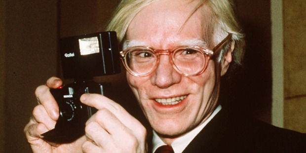 Andy Warhol smiles for the camera, New York, 1976. Photo / AP