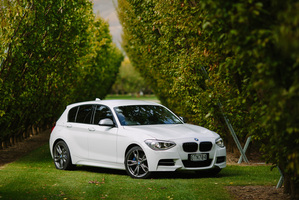 The more aggressive front and lower stance differentiate the M135i from 1 Series siblings. Photo / Simon Darby