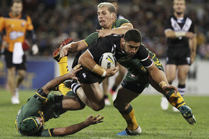 CANBERRA, AUSTRALIA - APRIL 19: Jesse Bromwich of the Kiwis is tackled during the ANZAC Test match between the Australian Kangaroos and the New Zealand Kiwis. Photo / Getty Images.