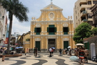 Visitors admire the pastel beneficence of St Dominic's Church in Macau. Photo / Paul Rush