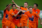 AS Dragon players celebrate a goal during the 2013 OFC Champions League match between Auckland City FC and AS Dragon. Photo / Dean Purcell