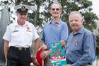 Mick O'Carroll, Jonny Walker and Fred Wilson with ANZAC day Poppies at the Navy Museum in Devonport. Photo / Greg Bowker