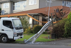 A truck on Vale St crashed into a power pole causing it to fall onto a house. Photo / John Borren