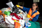 Sunshine Yates sorts through items discarded by a school. Photo / Brett Phibbs