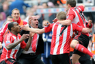 Sunderland's manager Paolo Di Canio, centre, celebrates with David Vaughan, after scoring his goal during their English Premier League soccer match against Newcastle United. Photo / AP
