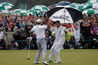 Australian Adam Scott celebrates with his Kiwi caddie Steve Williams. Photo / AP