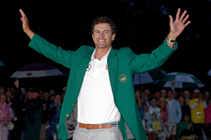 Adam Scott, of Australia, celebrates with his green jacket after winning the Masters golf tournament Sunday, April 14, 2013, in Augusta, Ga. (AP Photo/Matt Slocum)