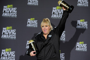 Rebel Wilson poses backstage with the awards for show host, breakthrough performance for Pitch Perfect and best musical moment for Pitch Perfect at the MTV Movie Awards. Photo / AP