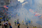 Two bombs exploded near the finish line yesterday, killing at least two people and wounding many others. Photo / Boston Globe via AP