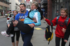 A woman is carried from the scene of two blasts at the finish line of the Boston Marathon. Photo / AP