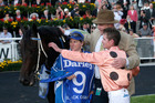 Trainer Peter Moody, back with hat, jockey Luke Nolen and strapper Donna Fisher after Black Caviar won the TJ Smith Stakes last Saturday. Photo / AP