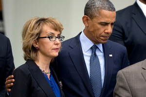 President Barack Obama, right, puts his arm around former Rep. Gabrielle Giffords, D-Ariz., before he speaks in the Rose Garden at the White House in Washington. Photo / AP