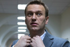 Russian opposition activist Alexey Navalny talks to journalists outside a courtroom in Moscow, Russia. Photo / AP