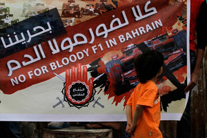 A poster in the Bahraini village of Malkiya highlights opposition to the grand prix, which protesters say is helping the country's repressive government. Photo / AP