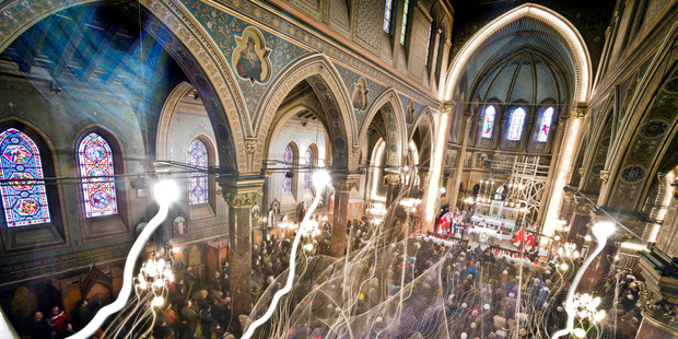 Romanian Catholic worshipers attend a religious service at St Joseph's Cathedral in Bucharest, Romania. Photo / AP