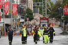 A USAR team walks along Manchester Street days after the February 22, 2011 earthquake in Christchurch. Photo / Greg Bowker