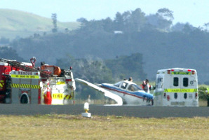 Emergency Services surround a plane at Whangarei Airport. Photo / File / Tania Webb
