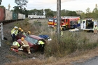 A woman was taken to hospital after her car was shunted by a train yesterday near Waipukurau. Photo / Hawke's Bay Today