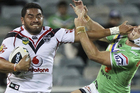 Konrad Hurrell of the Warriors fends off Jarrod Croker of the Raiders during the round six NRL match between the Canberra Raiders and the New Zealand Warriors. Photo / Getty Images.