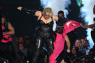 Rebel Wilson changes out of her pink jumpsuit into a black leather outfit. Photo/AP