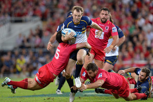 Jesse Mogg of the Brumbies attempts to break through the Reds defence.  Photo / Getty Images