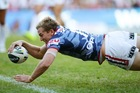 Mitchell Aubusson of the Roosters dives over to score a try. Photo / Getty Images