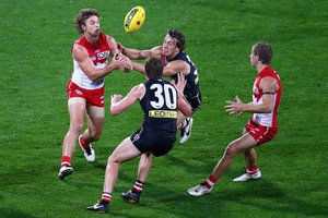 Dane Rampe of the Swans handballs during the round five AFL match between the St Kilda Saints and the Sydney Swans. Photo / Getty Images