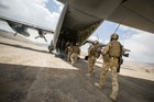 Final departure of personnel from Kiwi Base. The last soldiers board the C-130 Hercules. Photo / NZDF