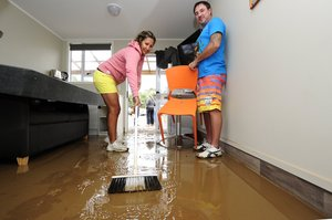 Tara and Lee Wynyard opened their home to 16 evacuees from the Waihi Beach Top 10 Holiday Park then turned up the next day to help with the clean-up. Photo / George Novak