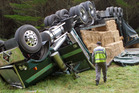 Police set up diversions after a truck and trailer unit flipped on SH1 near Atiamuri. Photo / Stephen Parker