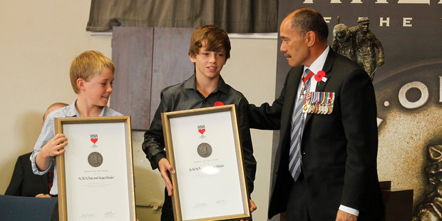 Will White and Sergio Schuler receive the RSA ANZAC of the Year award from His Excellency Lieutenant General The Right Honourable Sir Jerry Mataparae in Waihi. Photo / Christine Cornege