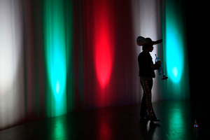 A member of the De Mi Tierra Mariachi group waits to compete at the Mexico Theater in Quito, Ecuador. Photo / AP