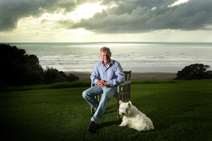 Bryan Gould and Lachie the dog, pictured on the front lawn of his property near Opotiki in the Bay of Plenty. Photo / Alan Gibson