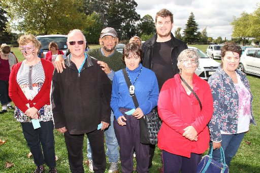 magie b's bi-annual truck run from Masterton's Solway Showgrounds. The truck run is a day out for for clients under Idea Services (IHC) and Autism New Zealand's care, plus members of the community who like trucks. Clients from Idea Services pose for the p