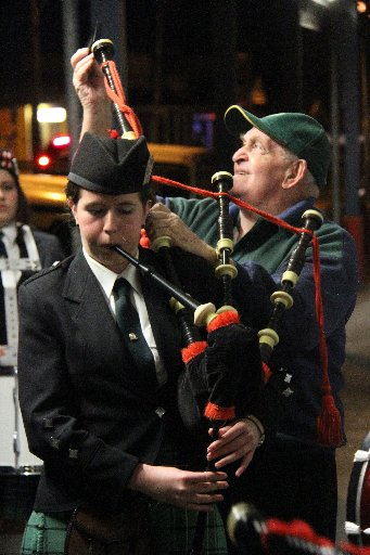 Anzac Day dawn service at Martinborough. John Frater tunes the bagpipes for Georgia Morrison, of the Fern & Whistle Wairarapa Pipe Band.