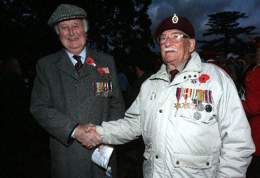 Anzac Day Dawn Ceremony of Remberance at the Cenotaph at Queen Elizabeth Park, Masterton.  John Lawrence, Royal NZ Navy, shakes hands after the service with John Frost, Royal Signals.