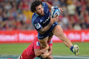 Rene Ranger of the Blues takes on the defence during the round 11 Super Rugby match between the Reds and the Blues. Photo / Getty Images.