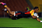 Chiefs' Bundee Aki dives for the try during the round 11 Super Rugby match between the Chiefs and the Sharks. Photo / Getty Images.