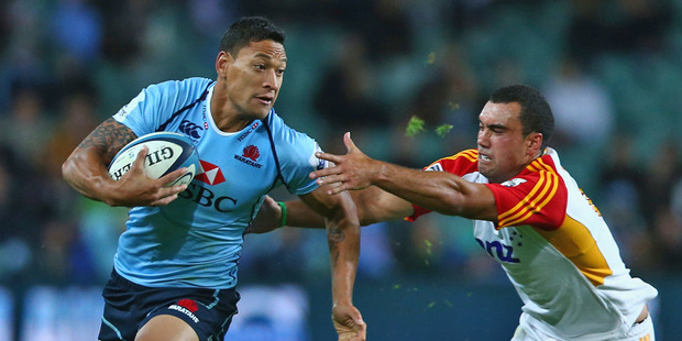 Israel Folau scored a try - showcasing all of his AFL skills when effortlessly plucking the ball from the air between two Chiefs - and made several last-ditch try-saving tackles. Photo / Getty Images