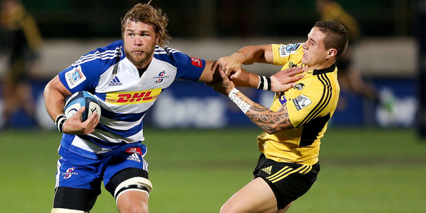 Duane Vermeulen of the Stormers fends TJ Perenara of the Hurricanes during the round 11 Super Rugby match between the Hurricanes and the Stormers. Photo / Getty Images,