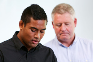 Julian Savea reads his statement yesterday, watched by rugby union chief executive Steve Tew. Photo / Getty Images