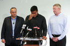 A tearful Julian Savea (centre) talks about his assault charge, flanked by Hurricanes CEO James Te Puni (left) and NZRU CEO Steve Tew. Photo / Getty Images