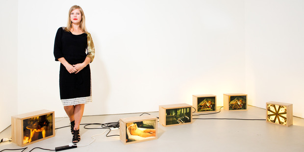 Art Curator Danae Mossman at Hopkinson Cundy Gallery with work by Tahi Moore. Photo / Babiche Martens