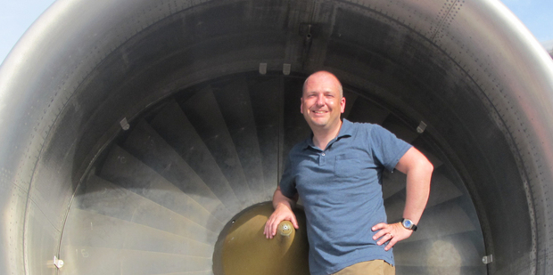 Chris Reed stands in the engine cowling of a Boeing 747 at the Qantas Founders' Museum in Longreach, Queensland. Photo / Supplied