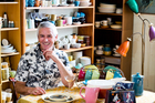 Avid Crown Lynn collector Robert Lloyd sits amongst his collection of 45 years. Photo / Babiche Martens